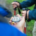 Hikers checking direction with compass.