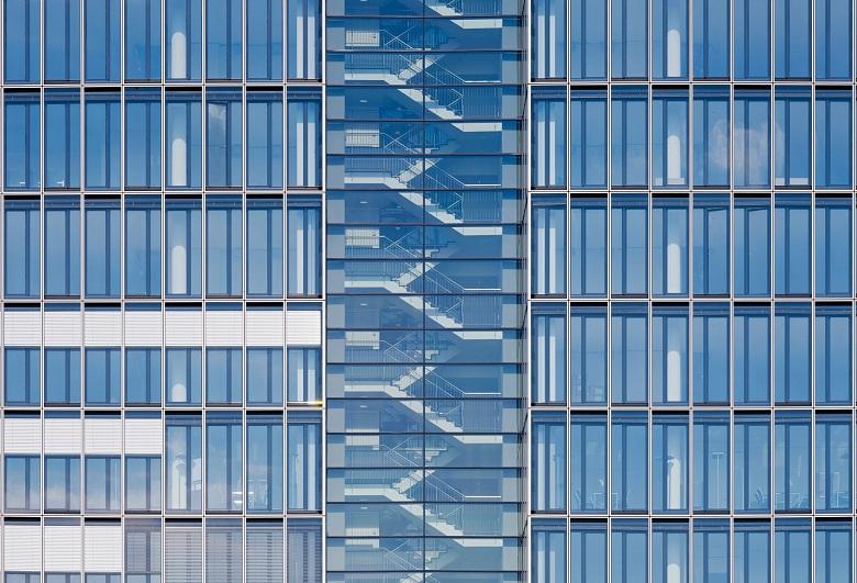 Office building stairwell seen through windows