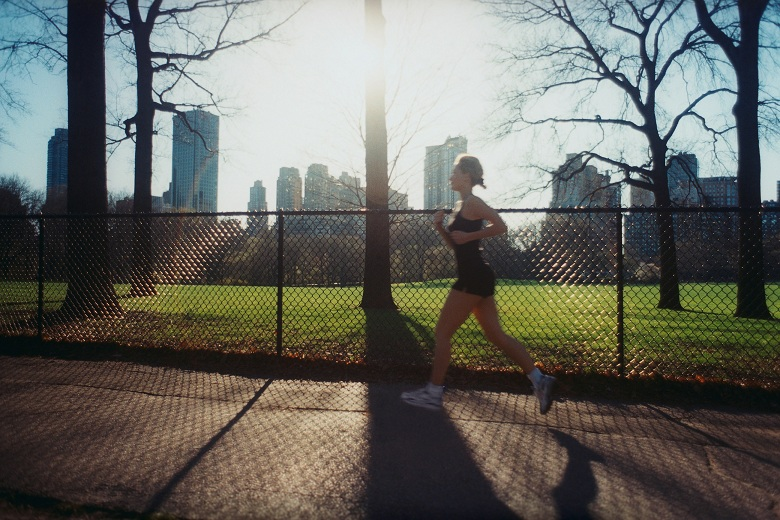 Woman Jogging in City Park