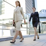 Businesswomen walking on bridge