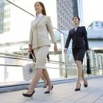 Businesswomen walking on bridge