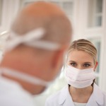 Germany Bavaria Landsberg Dentist and Female Dentist Assistant wearing mask