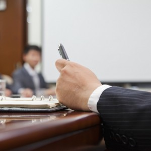 Close Up of Businessman's Hand Holding a Pen