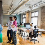 Group of entrepreneurs working in creative office space