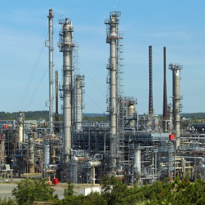 View of refinery plant against blue background
