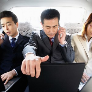 Businesspeople Working in Car