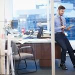 Businessman at modern office --- Image by © Hero/Corbis