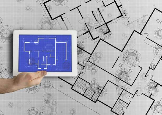 Digital tablet displaying blueprint --- Image by © Wavebreak Media Ltd./Corbis