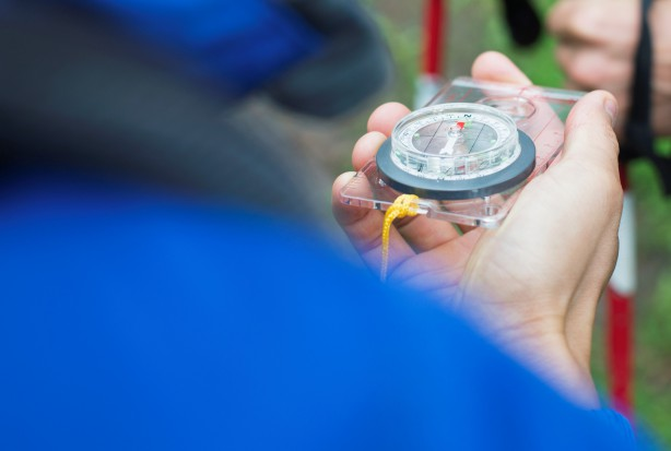 20 Jul 2012 --- Hikers checking direction with compass. --- Image by © Hero/Corbis
