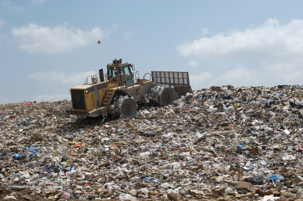 Landfill Compactor in a Landfill --- Image by © moodboard/Corbis